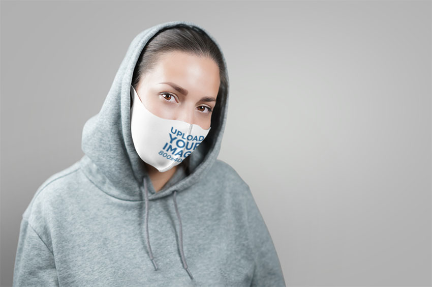 Clothing Templates Face Mask Mockup Featuring a Woman in a Studio