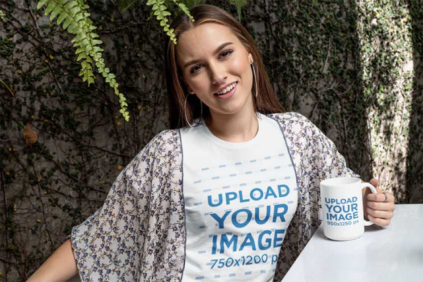 Mockup of a Woman Wearing a T-Shirt Against a Wall Covered in Leaves