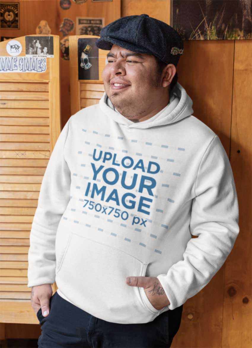 Hoodie Mockup of a Man Leaning on a Wooden Wall