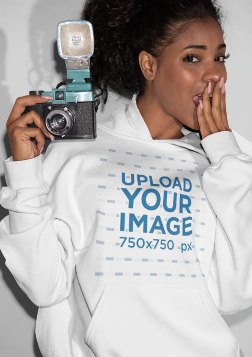 Hoodie Mockup Featuring a Woman Posing With a Camera