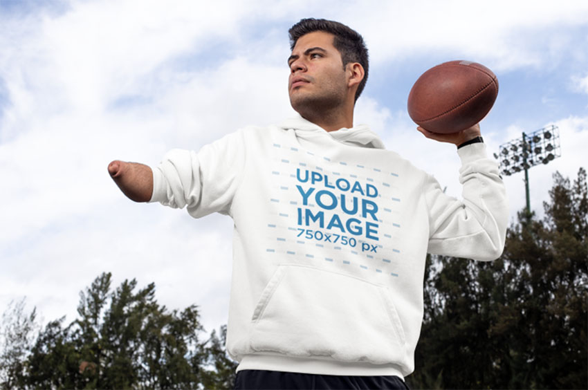 Hoodie Mockup Template of a Man Throwing a Football