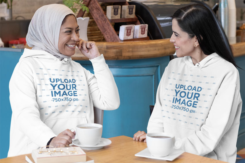 Pullover Hoodie Mockup Template with Two Women Chatting