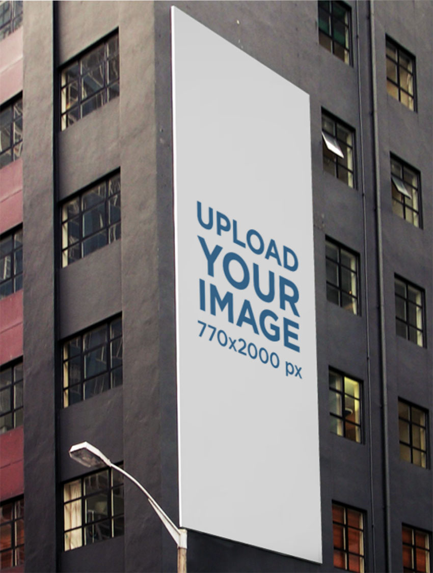 Vertical Wall Billboard Mockup on a Gray Modern Building
