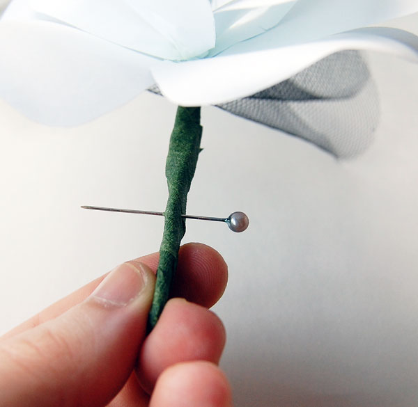 Add a pin to the boutonniere
