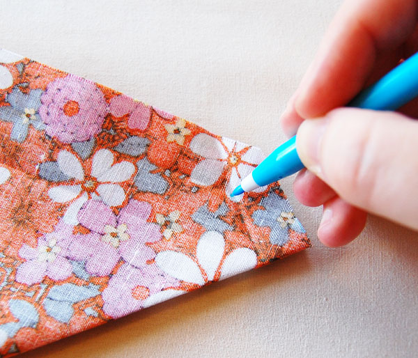 Pin or use fabric clips to hold your fabric together straight