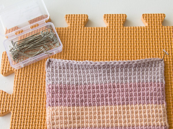 pin your piece flat to the blocking board