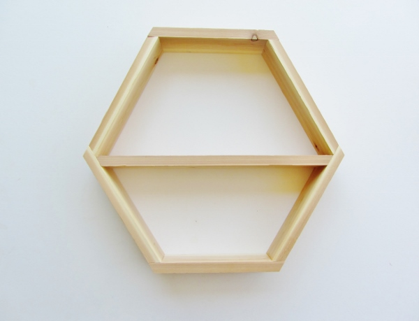 Finished wooden geometric hexagonal shelf