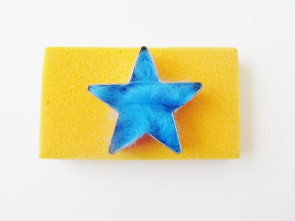 Place the cookie cutter on the sponge