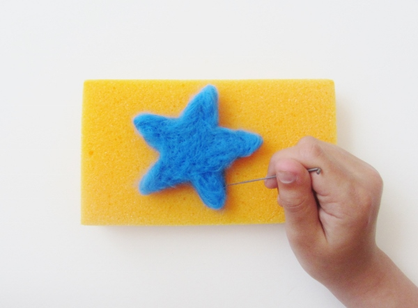 Continue using the felting needle to refine the shape