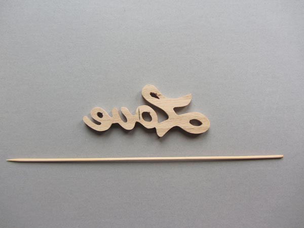 On the back side of the of the word mark where the anchor will be placed