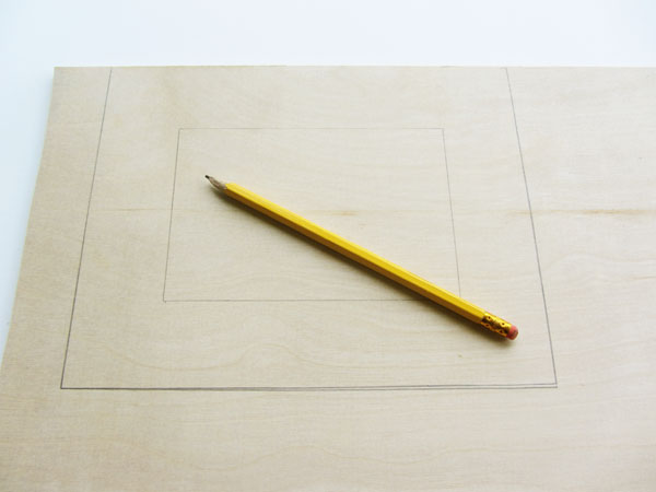 Center and trace a rectangle inside the rectangle you previously drew