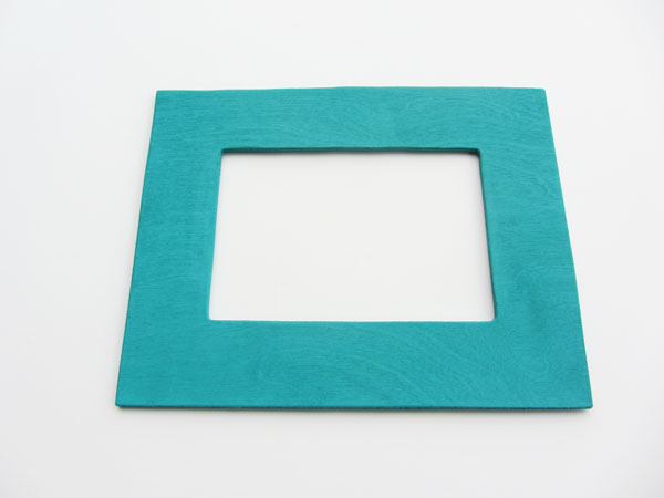 give your frame insert a coat of paint or stain