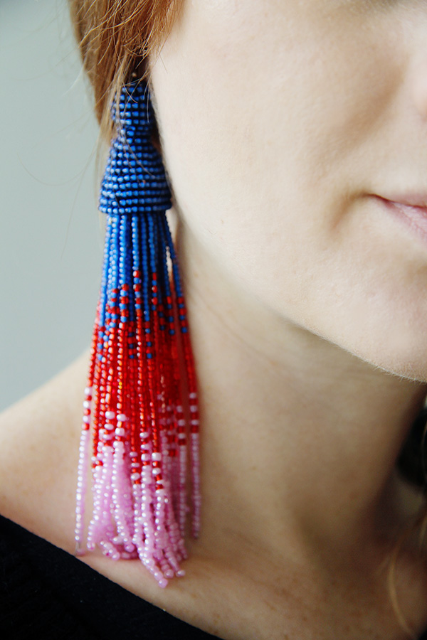Tassel earring shown on a model