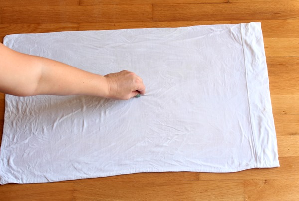pinch a bit of fabric from the center of the pillow case