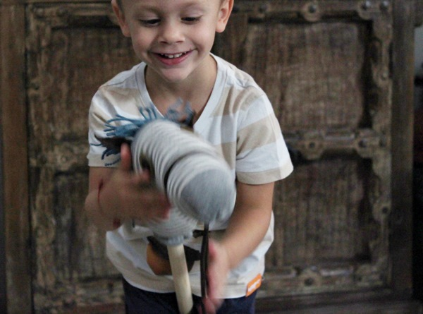 Child playing with hobby horse