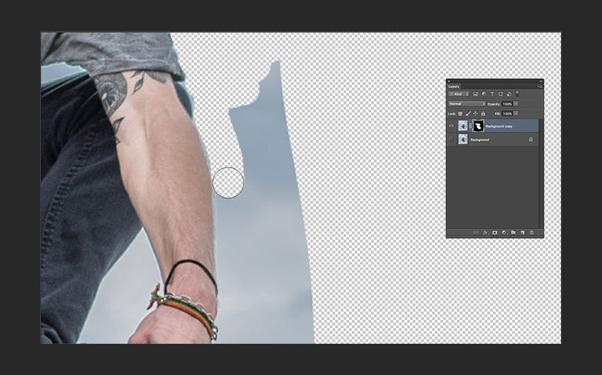 Using the Brush Tool to clean up details of the image