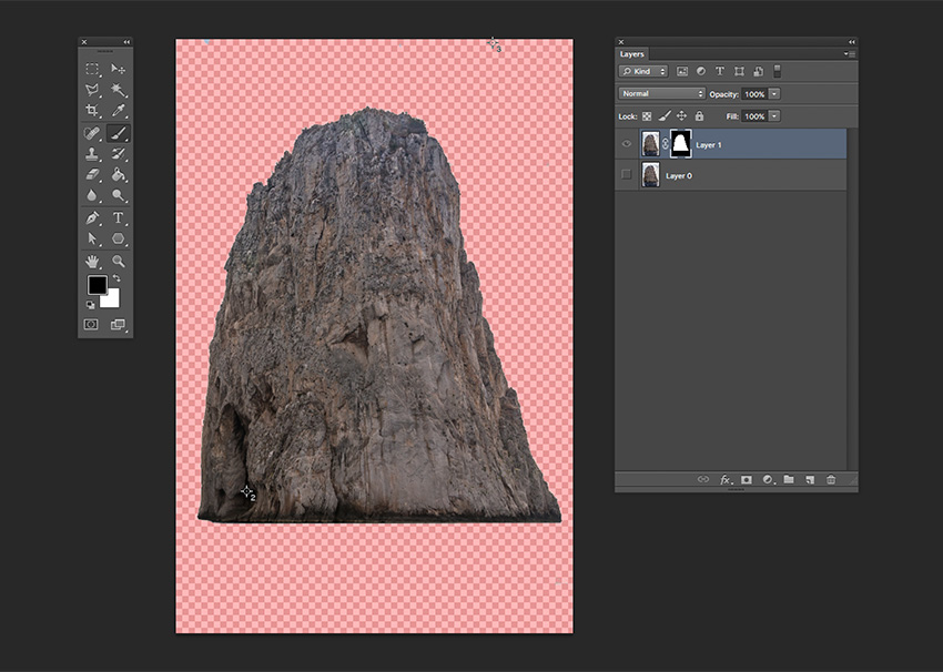 Remove the water under the rock using the Brush Tool