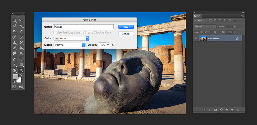Open the statue image from Envato Elements in Photoshop and unlock the layer