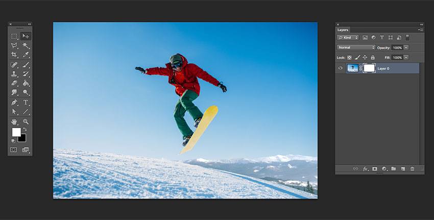 Open the snowboarder image separately and add a layer mask