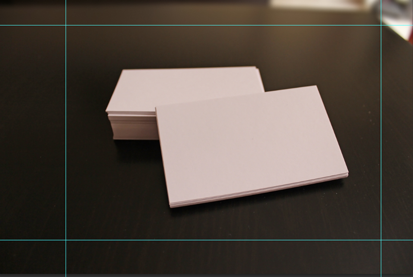 How to design elegant business card mockups using smart objects in white business cards on dark brown table crop guides in photoshop reheart Images