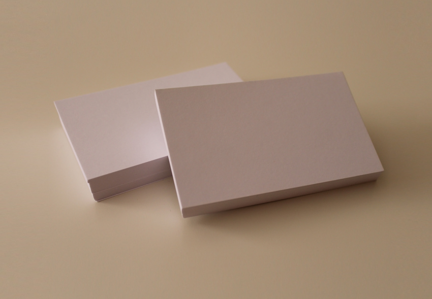 White Business Cards on white clear table psd template