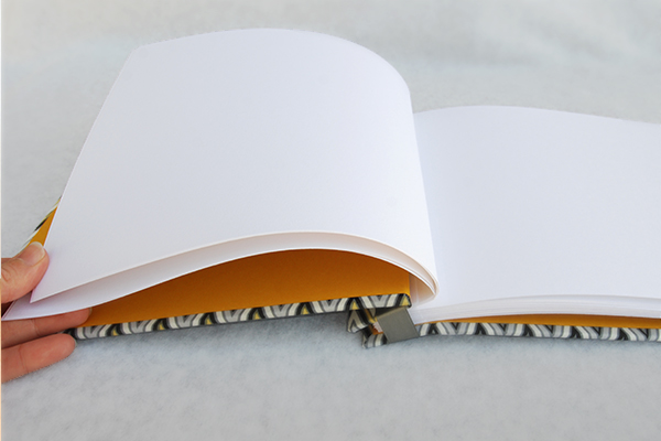 How to bind a scrapbook with removable pages if the ribbon gets too wrinkled try ironing it on a low setting before re binding your book solutioingenieria Gallery