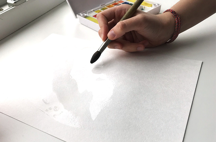 Adding water to the watercolor paper