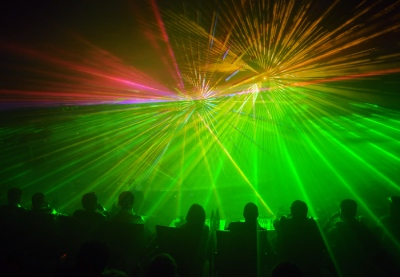 Row of people facing a laser light show pnz3htg%20(2)