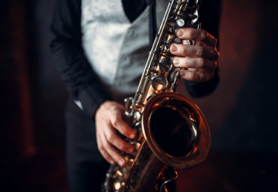 Jazz man hands holding saxophone closeup pmxqnrk%20(2)