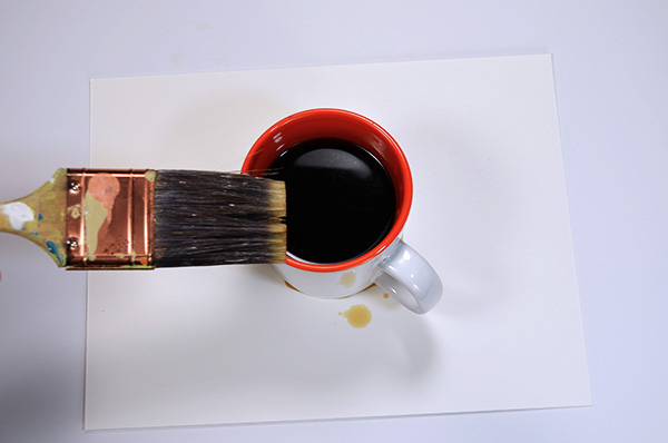 Apply the coffee to the rim with a brush or sponge