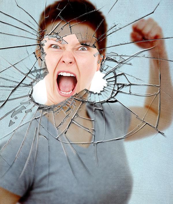 FInal effect angry woman punching glass