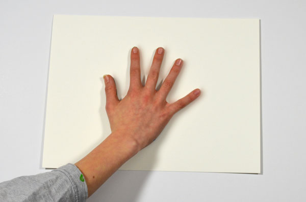 Press the hand onto the paper