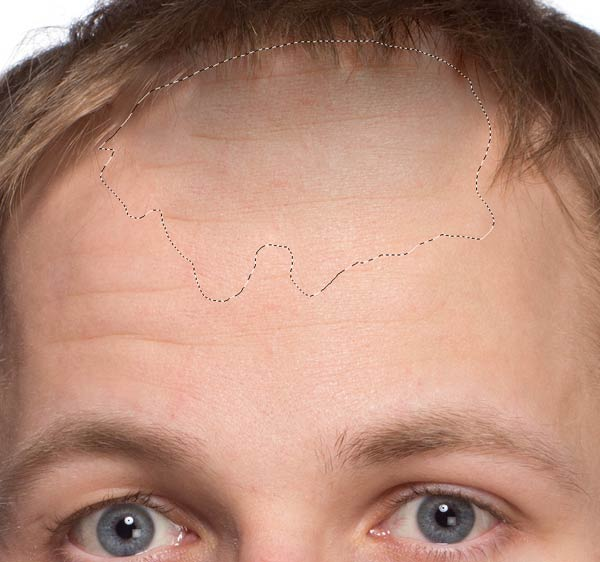 Remove the bangs to create a receding hairline