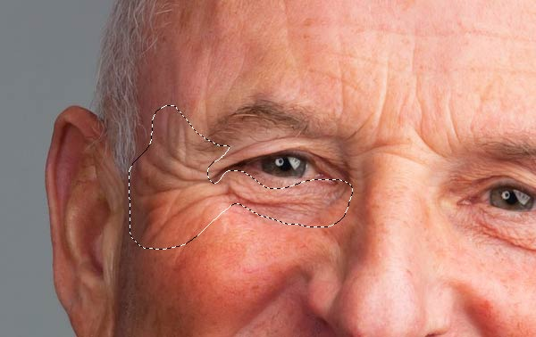 Copy a selection of wrinkles from the elderly mans face