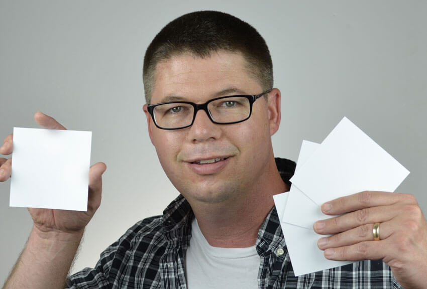 Shoot the cover pose with blank pieces of cardstock