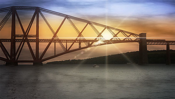 The final look of a sunset scene behind the bridge uses a lens flare to create the sun