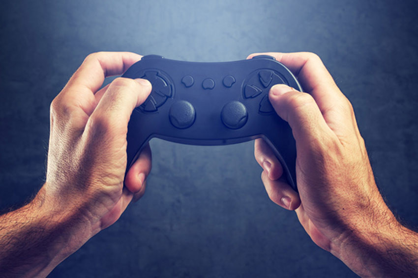 hands grasping a gaming control pad