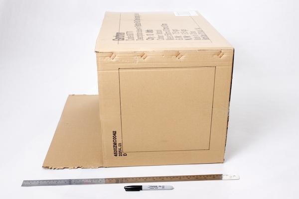 Ruler and marker alongside the cardboard box