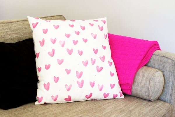 Photo of patterned pillow on a sofa