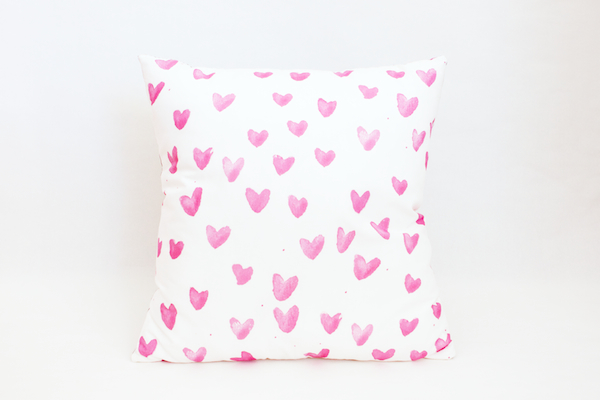 Photo of a patterned pillow on a plain white background