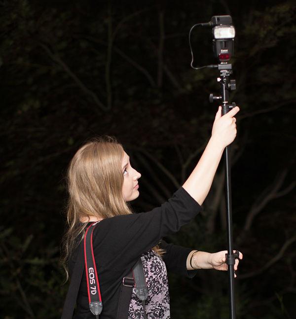 photographers assistant adjusting a flash unit
