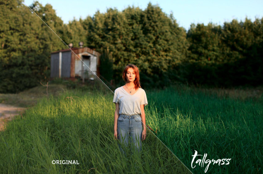 Woman in a white t-shirt and blue jeans standing in a field of green grass