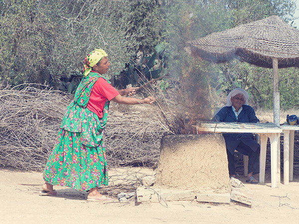 Tunisian  lady cooking bread