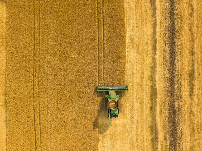 Hot Shots: Aerial Photo of a Farming Combine Harvesting Wheat