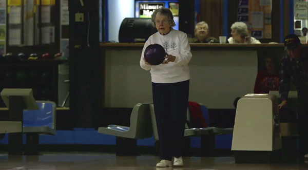 Older woman bowling