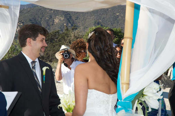 Wedding guest interrupts marriage ceremony to take a picture Photography by Kim Colombini