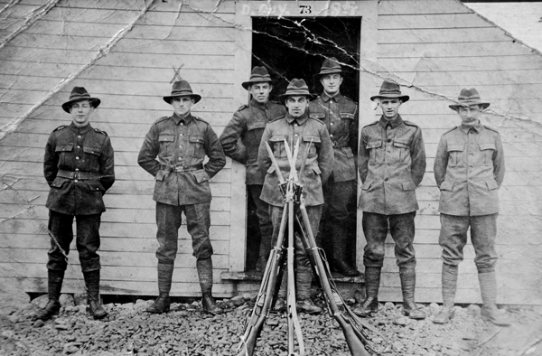 WWI military men in front of barracks