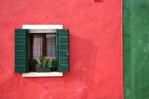 Red wall with green shutters