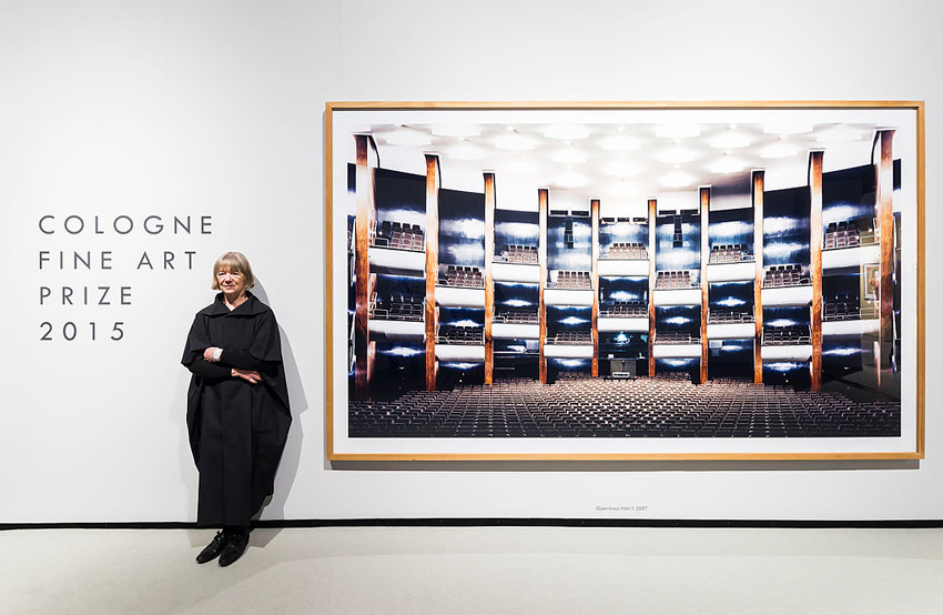 Photographer Candida Hfer stands beside one of her winning color photographs