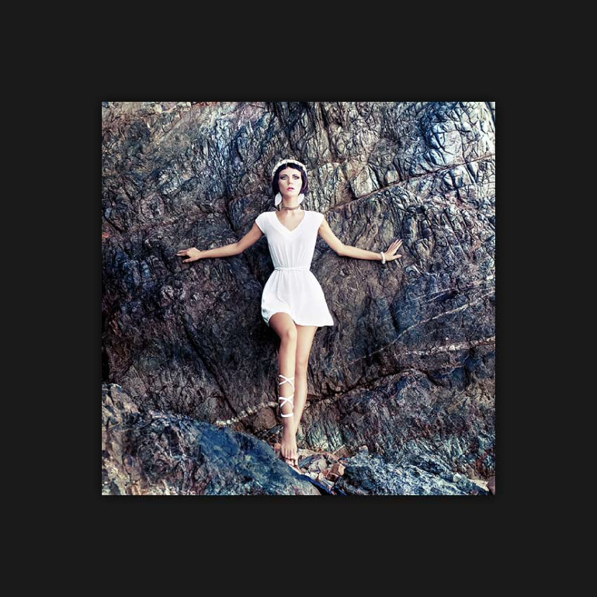 sensual girl on the rocks image